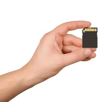 Ręka trzyma kartę pamięci sd czarny na białym tle