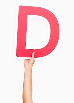 Ręka trzyma literę d