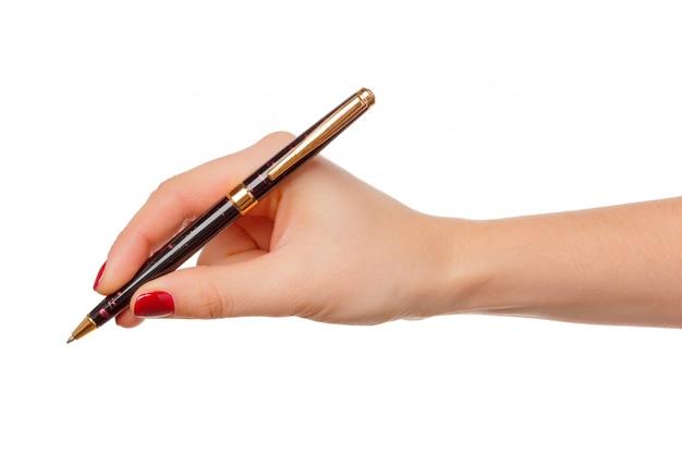 Ręka trzyma ołówek