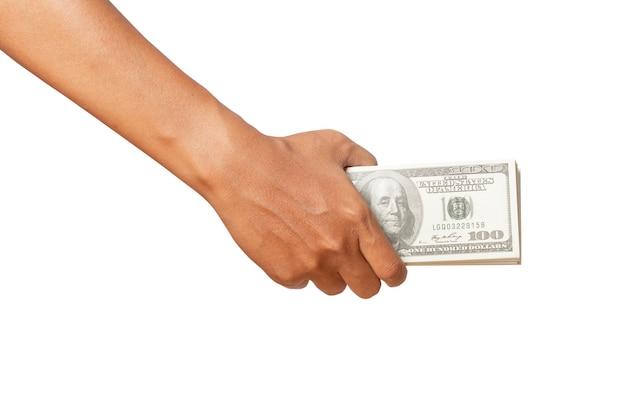 Ręka trzyma pieniądze dolarów na białym tle.