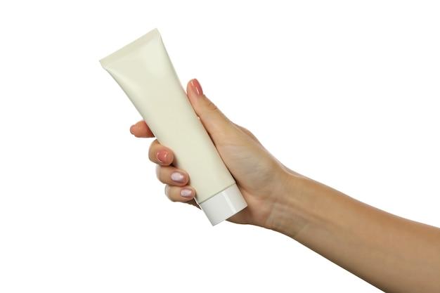 Ręka trzyma tubkę kosmetyczną