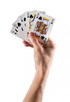 Ręka trzymająca karty tworzące strit