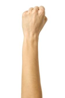 Ręka zaciśnięta w pięść. obraz pionowy. kobieta ręka z francuskim manicure gestykuluje na białym tle na białej ścianie. część serii