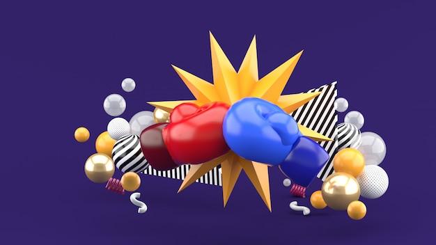 Rękawice bokserskie należą do kolorowych kulek na fioletowym tle. renderowania 3d.