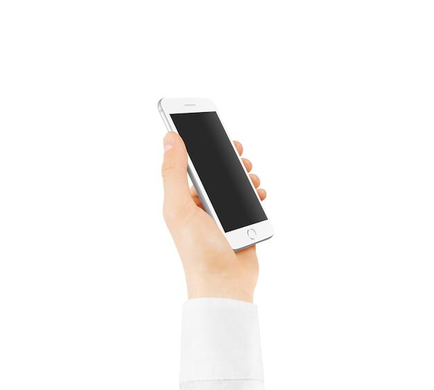 Ręki mienia smsrtphone z pustym czerń ekranem odizolowywającym