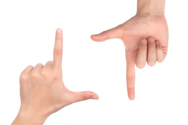Ręki obramiają skład odizolowywającego na białym tle. to zdjęcie ma ścieżkę przycinającą, aby ułatwić obsługę.