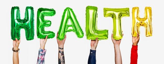 Ręki pokazuje zdrowie balonów słowo