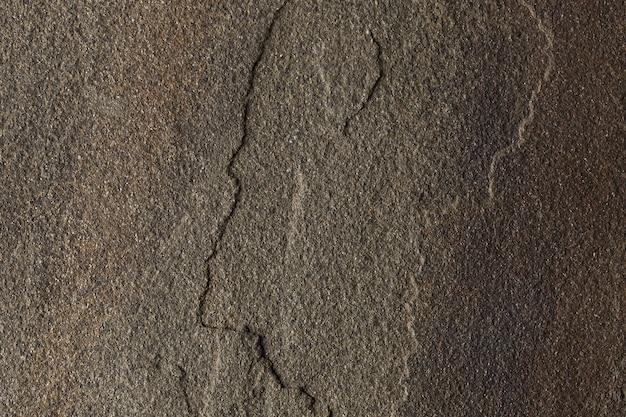 Relief powierzchni wielobarwnych kamieni naturalnych na tle.