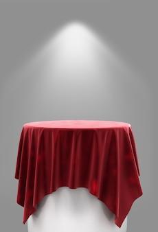 Renderingu 3d czerwonego weluru na okrągłym cokole na szarym tle z oświetleniem