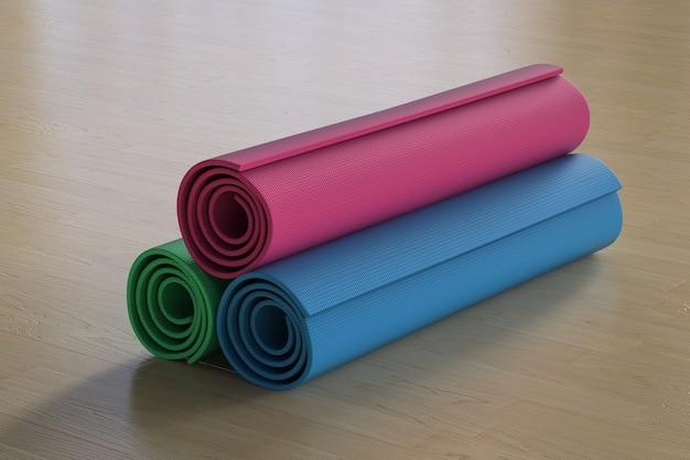 Renderowania 3d stos kolorowych mat do jogi na podłodze