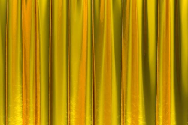 Renderowanie 3d, luksusowe złote tło streszczenie tkanina lub płynna fala lub faliste fałdy grunge tekstury jedwabiu