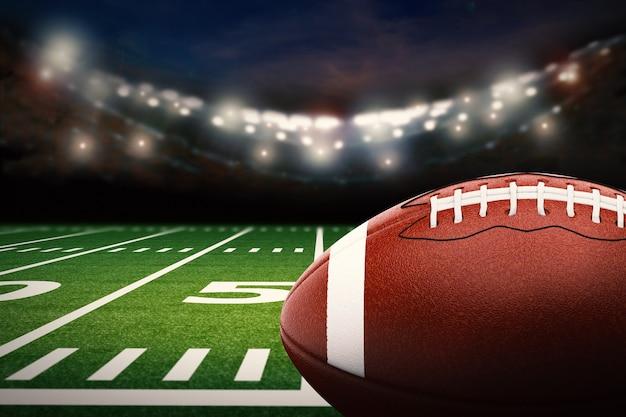 Renderowanie 3d piłki futbolu amerykańskiego na zielonym polu
