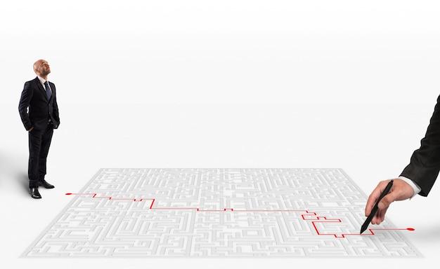 Renderowanie 3d ręka rysuje czerwonym piórem właściwą drogę wyjścia z labiryntu