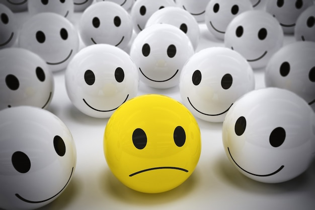 Renderowanie 3d żółta piłka ze smutną twarzą wśród tak wielu białych uśmiechniętych piłek. szczęśliwy zespół wspiera swojego lidera