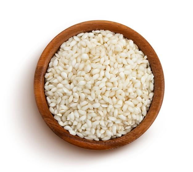 Risotto ryż odizolowywający na bielu z ścinek ścieżką