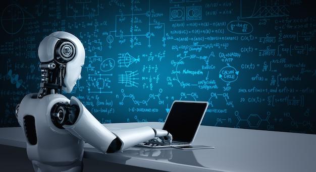 Robot humanoidalny używa laptopa i siada przy stole do nauki inżynierii