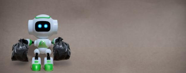 Robot trzymać worki na śmieci technologii recyklingu środowiska na szarym tle