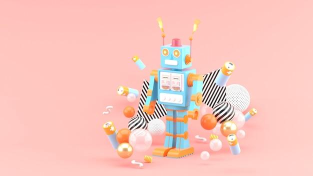 Roboty znajdują się wśród baterii i kolorowych kulek na różowej przestrzeni