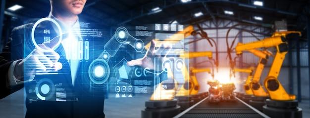 Robotyczne ramię robota kontrolnego w fabryce