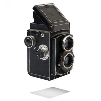 Rocznik kamera na białym tle