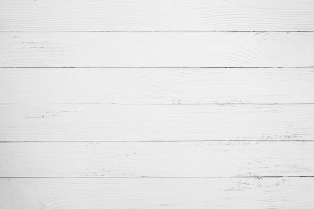 Rocznika biały drewniany tło - stara wietrzejąca drewniana deska malująca w białym kolorze.
