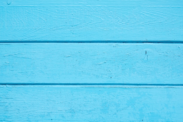 Rocznika drewniany narzut w błękitnego koloru błękitnym drewnianym tle