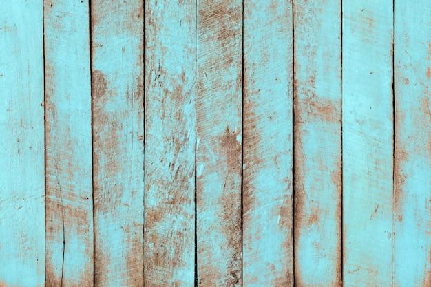Rocznika tła plażowy drewno - stara wyblakła drewniana deska malująca w turkusowego błękita pastelowym kolorze.