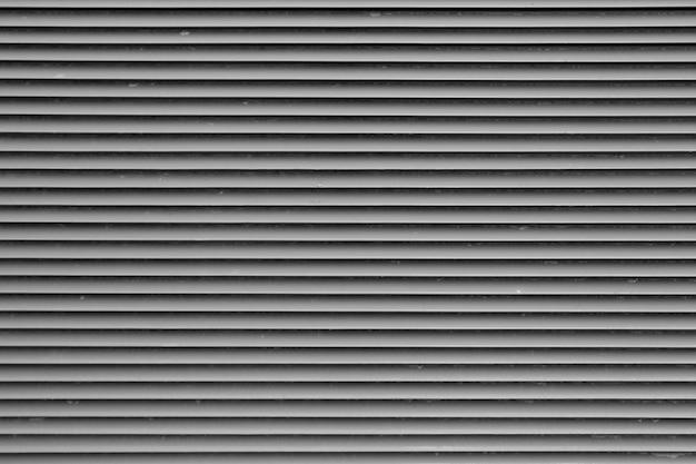 Rolety zewnętrzne, okiennice. teksturowane tło. metalowe żaluzje ochronne