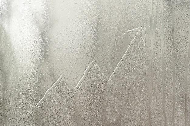 Rosnący wykres na mroźnym szkle okiennym. pomysł na biznes