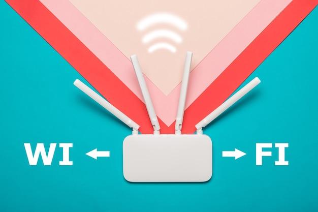 Router wi-fi z ikoną sygnału na wielokolorowym tle. organizacja sieci bezprzewodowych.