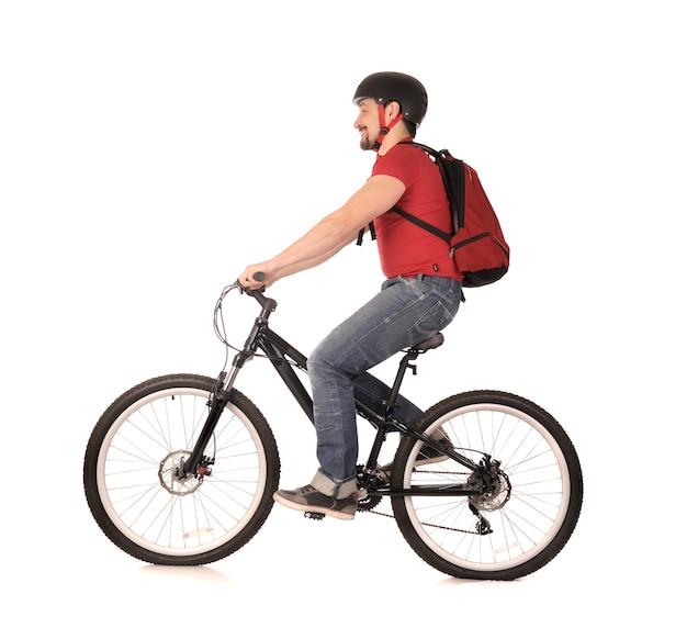 Rowerzysta na białym tle