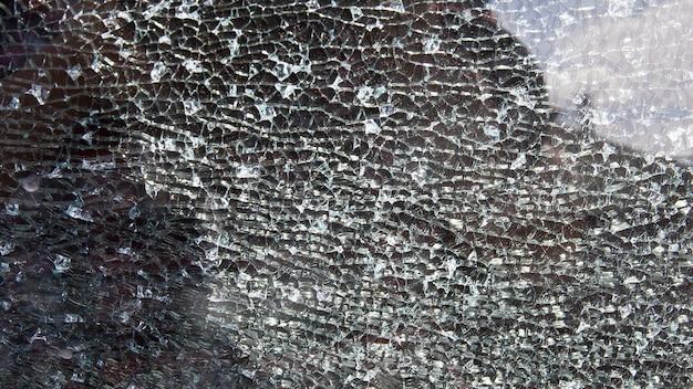 Rozbite szkło samochodowe na światło, tekstura tło