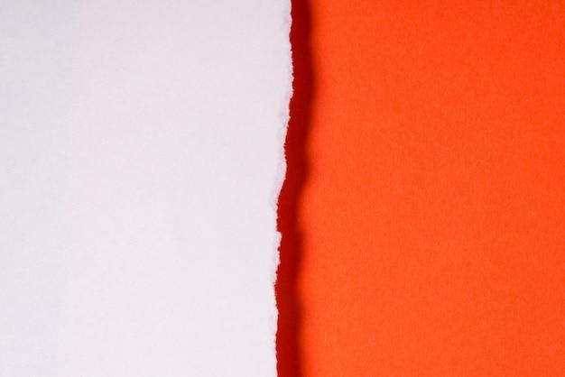 Rozdarty arkusz papieru, teksturowanej tło