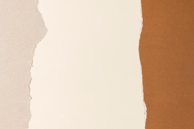 Rozdarty beżowy papier rama rzemieślnicza ręcznie robione tło w odcieniach ziemi
