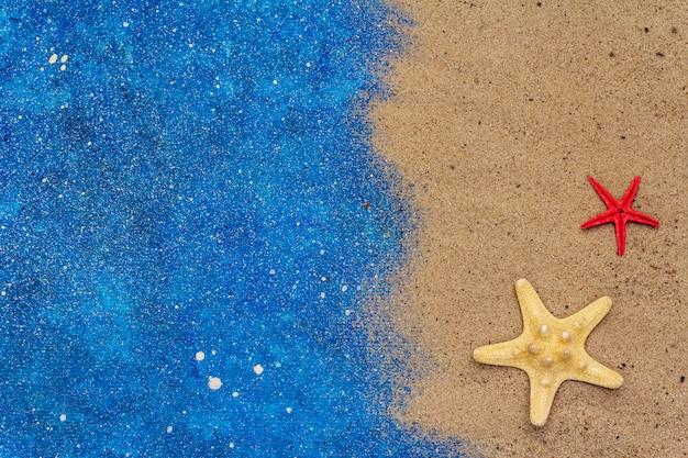 Rozgwiazdy, piasek i brokat