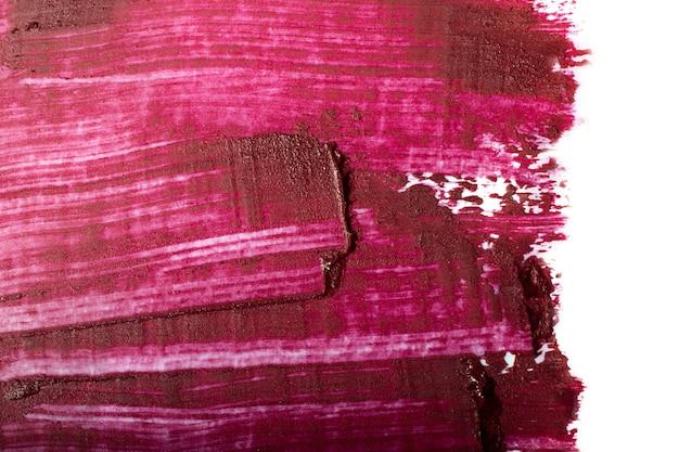 Rozmaz czerwonej szminki, na białym tle. kosmetyki tło z negatywną przestrzenią, duży baner.