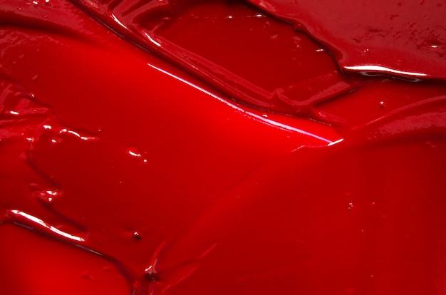 Rozmaz i tekstura tło czerwona szminka lub farba akrylowa.
