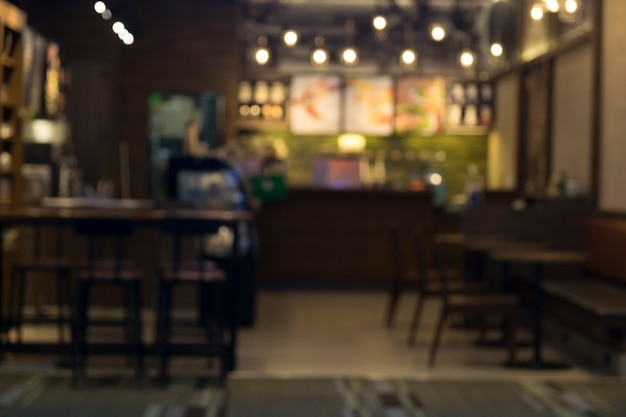 Rozmycie kawiarni kawiarni sklep z bokeh tle.