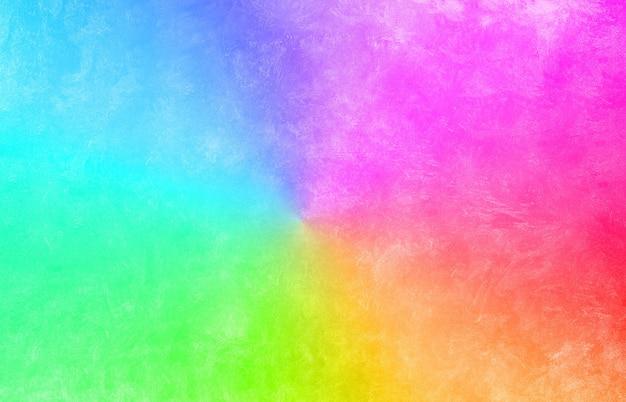 Rozmyty gradient kolorów rgb na teksturze betonu. różowy, zielony, niebieski i czerwony kolor tła