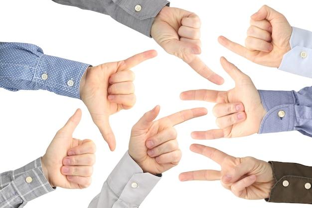 Różne gesty męskich dłoni między sobą na białym tle.