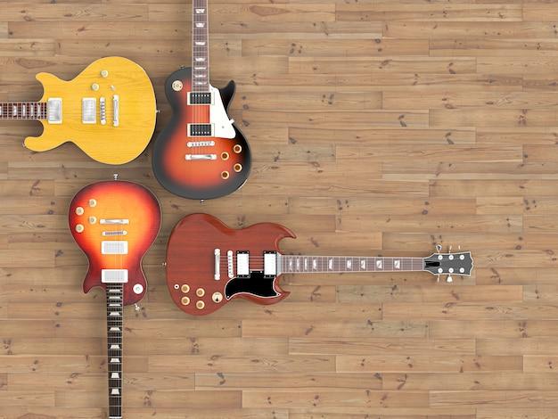 Różne gitary na drewnianych podłogach, oglądane z góry.