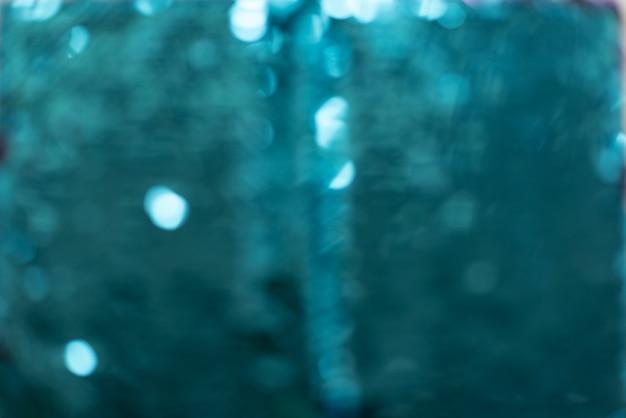 Różne odcienie turkusowych cekinów tworzących streszczenie teksturowanej tło
