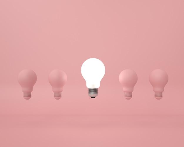 Różnica żarówka na różowo. minimalna koncepcja kreatywnego pomysłu.