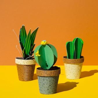 Różnorodne kaktusy z papieru origami w doniczkach