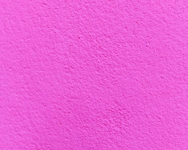 Różowa cementowa lub betonowa ściana tekstura dla tła.