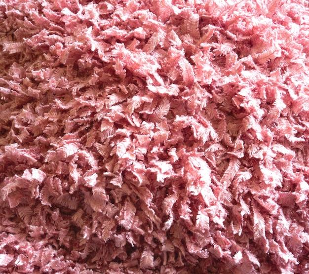 Różowa delikatna wełniana puszysta tkanina na teksturę tła