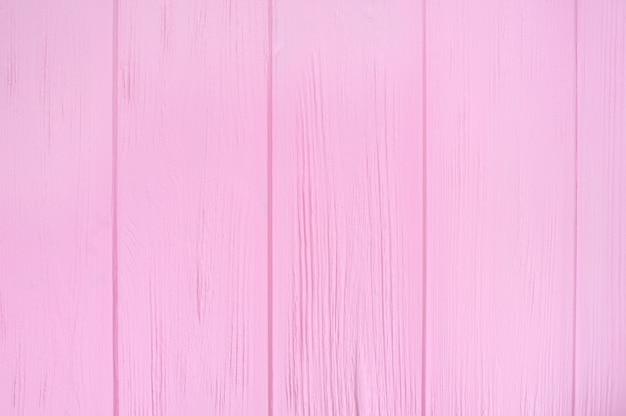 Różowa drewniana podłoga tekstura. wzór deski powierzchnia pomalowana pastelowo ściana
