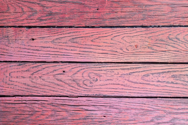Różowa drewniana powierzchnia