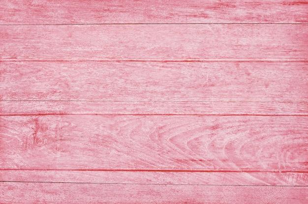 Różowa drewniana ściana deski, tekstura drewna kory ze starym naturalnym wzorem.