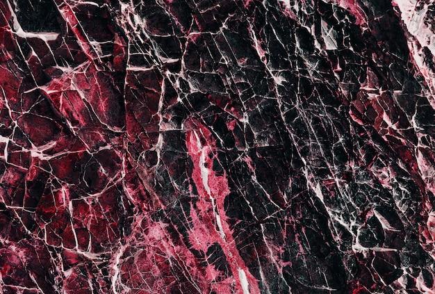 Różowa i czarna kamienna tekstura